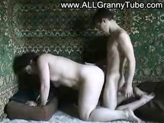juvenile lad against tall aged kissing