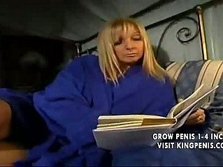 blond italian mother plays with son